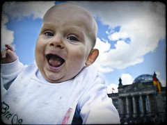 A baby in Berlin: Reichstag II (manganite) Tags: family boy portrait people baby black blur color berlin cute face architecture clouds digital photoshop buildings catchycolors germany children de geotagged happy iso200 kid blurry xpro nikon funny colorful europe child cloudy tl head framed young blurred reichstag frame cropped d200 nikkor dslr 222 lightroom f50 leander day222 takuma lensblur structured nikond200 18200mmf3556 manganite colorefexpro filterforge l03 11500sec geo:lon=13373666 repost1 date:month=september date:day=11 date:year=2009 leandertakuma format:ratio=43 format:orientation=landscape geo:lat=52518233 11500secatf50 familygetty2010