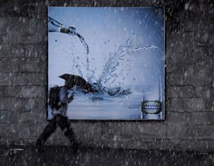 Leben pur (Dreamer7112) Tags: street blue people snow wall umbrella ads walking advertising snowflakes schweiz switzerland spring bottle nikon europe publicidad suisse suiza propaganda swiss candid zurich ad streetphotography streetscene billboard advertisement sua billboards snowing zrich juxtaposition publicity werbung svizzera umbrellas advertisements zuerich publicit plakat nestl reklam walkin decisivemoment publicidade mercadotecnia mineralwater d300 acrossthestreet zurigo purelife  rclame pubblicita streetadvertising henniez  werbeplakat  werbeplakate decisivemoments dreamer7112 street5bob  nikond300  top30blue ostrellina lebenpur clipcook umbrellastories phvalue kuwaitartphotoclub milobaumgartner