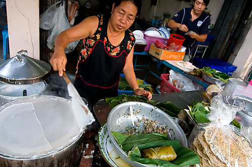 Mae Ut making khanom paak mor, Vietnamese-style steamed noodle, at her restaurant in Nong Khai, Thailand
