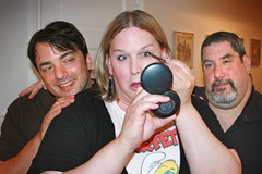 Tracy Tyler puts on makeup as Marc Felion and Marc Peurye watch