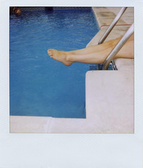 point those toes! (Loulou H) Tags: madrid pool polaroid hotel spain legs 600