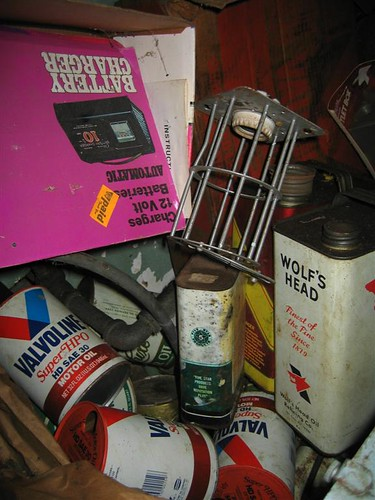 Old oil cans and boxes