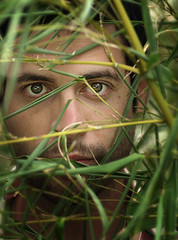 Keep me hidden (aknacer) Tags: portrait man green self eyes alone head aaron bamboo hidden jungle stalker stalking nace 365days strobist 1onexplore trianglestrobist aknacer aaronnace