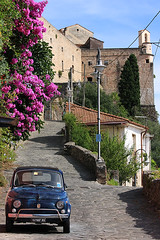 Postcard from Italy (Pawel Boguslawski) Tags: italy castle car canon blossom postcard hill massa 40d