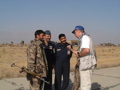Peter negotiating with an Indian air crew and a Northern Alliance soldier in Afghanistan (2001)