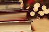 (ginnerobot) Tags: 50mm reading three bokeh books stack