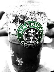 Starbucks  [Explored] (Naina Iqbal) Tags: blackandwhite bw snow color macro coffee canon star powershot starbucks flakes bucks naina coloraccent g9 explored canonpowershotg9 powershotg9 hunaina nainaphotography