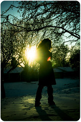 36.365 I was standing on the surface of a perforated sphere... (erin.marie.hall) Tags: trees winter sunset shadow woman selfportrait snow cold ice me girl silhouette branches coat lensflare flare 365 icicles demosthenes erinmariehall