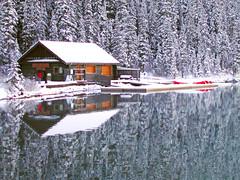 Lake Louise Boathouse (Sunny27) Tags: trees winter snow canada reflection water dock cabin scenery canoe alberta banff boathouse reflexions banf