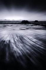Solitude (JN) Tags: ocean sea beach sunrise hawaii coast oahu sandy east duotone 1735mmf28d sandybeach dodgeburn d700 nikon1735mm nikond700 nikon1735mmf28