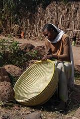 Woman near Bahir Dar, Ethiopia (Marjan de B) Tags: travel vacation woman slr digital scarf nikon basket traditional 2008 bahirdar weaving ehtiopia d80 deblaauwpix