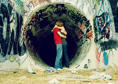 In A Cave (Amanda) Tags: old art abandoned love film colors beautiful trash self dark underground hug kiss couple grafitti hole tube romance dirty litter embrace ghetto nikonfe 2007