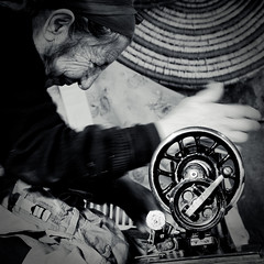 sewing (SurfaceSpotting) Tags: old grandma portrait people blackandwhite bw monochrome canon blackwhite hands grandmother sewing cyprus human granny sewingmachine humans michaelides giagia  surfacespotting georgemichaelides tsestos