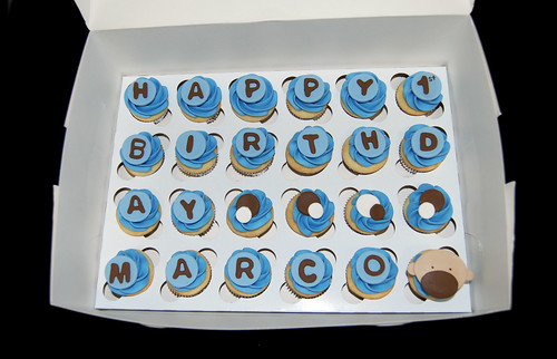 brown and blue birthday mini cupcakes with a monkey