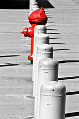 Odd one out? Or Nonconformity? (Lauren Cap) Tags: red blackandwhite water pattern different bright unique row line firehydrant repetition blocks column poles pillars rhythm individual individuality nonconformity individualism