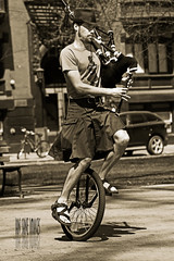 The Unipiper (Ian Sane) Tags: street musician man hat oregon portland photography university downtown kilt state sandals candid tshirt unicycle bagpipes performer the unipiper