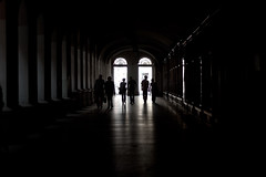 Budapest Walkway (TheFella) Tags: street light shadow people slr silhouette contrast digital canon photography eos photo alley europe hungary arch shadows pavement budapest arcade streetphotography silhouettes arches sidewalk photograph covered alleyway processing dslr pillars lowkey footpath pest magyarorszg 500d republicofhungary twtmespf