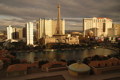 Las Vegas at Dusk (picturetakingone) Tags: las vegas dusk nevada strip paris bellagio fountain sunset lasvegasblvd lasvegasboulevard sky clouds light eiffel eiffeltower ballys planet hollywood sun sunshine building casino casinos planethollywood miniatures interestingness cloud oceanseleven cubanosinlasvegas view amature amateur miss america pagent lasvegas set swirl map architecture restaurant shadow lighting setting desert weather front coldfront nikon d 70 nikond70 cloudy day seen projectweather lasvegasstrip thestrip water 20000views twentythousand 2008 los missamerica pool