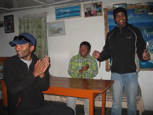 Mohan, happy Nima, and another guide sing Nepali songs for us