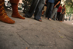 Waiting (mariaelise) Tags: feet waiting line sidewalk walkway moccasins backbooth baronvonbear