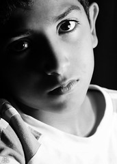 The Serious Look (FatoOoma Qatar ~) Tags: lighting camera light boy portrait bw baby white man black cute male men guy eye face look canon logo photo eyes focus flickr image serious little brother young picture handsome 2008 fatma doha qatar the abdullah chlid qatari flickcom 400d fatoooma 3bdullah