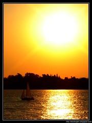 Sailing at dusk (DrGEN) Tags: santa sunset sky orange costa santafe argentina rio river atardecer dawn coast boat twilight sailing peace dusk paz down cielo rosario atardeceres fe parana navegando ceres bote velero anaranjado wpblog colourartaward drgen
