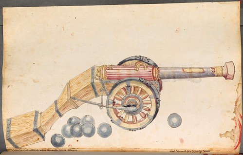 wood-mounted cannon on wheels and cannonballs