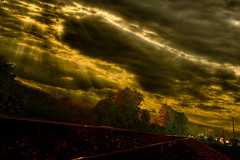 Journey (country_boy_shane) Tags: school trees red sky brown brick green college lines yellow composite clouds train living long exposure peace power darkness traffic angle shane path michigan wide perspective tracks surreal victory suburbs rays poles easy jam challenge beams looming transmission gravel challenging accomplishment gorski canonefs1022mmf3545usm clintontownship canon30d