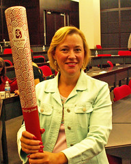 Barbara Nixon holding a Beijing Olympic torch