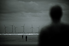 Where will it end? (dougchinnery.com) Tags: blue blackandwhite copyright sunlight men green beach scale ecology mono three blackwhite sand solitude waves dof looking wind farm signature grain statues depthoffield sparkle electricity duotone lonely distance staring toned duotoned barriers eco generation tone turning blades windfarm gormley lonliness crosby windpower lonelyness worksop carbonfootprint trashbit birdstrikes thefatcat44 dougchinnery bnirdstrike