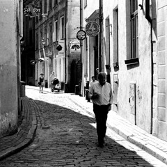 Riga (Peter Gutierrez) Tags: street old city urban bw white black film public square town photo ancient europe european pavement centre center baltic medieval latvia sidewalk peter gutierrez format eastern riga latvian livonia rga latvija rigan petergutierrez