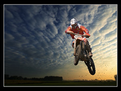 Riding out of the Sunset (guenterleitenbauer) Tags: pictures sunset art sports nature bike sport clouds austria google bravo flickr force power cross image kunst air fineart natur fine picture wolken images motorbike dirt chapeau moto com imaging dust bild motocross motorsports mx luft bilder helm motorsport gnter kampf hoch meisterschaft blueribbonwinner coolshot supershot fotografien guenter abigfave aplusphoto leitenbauer betterthangood wwwleitenbauernet micartttt sppringen luftstand micarttttperfectactionshots