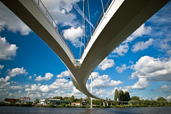 Split Bridge (roevin | Urban Capture) Tags: bridge blue sky water amsterdam clouds cyclists canal suspension thenetherlands pedestrians suburb rhine diemen rijn ijburg nescio nesciobrug theperfectphotographer
