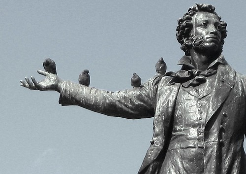 [Photo of birds sitting on a statue of Pushkin]