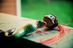 The Little Mermaid: Epilogue (_prachi_) Tags: usa abandoned toy xpro objects northcarolina raleigh armless mermaid tamron catchycolorsgreen 1750mmf28 pseudoxpro