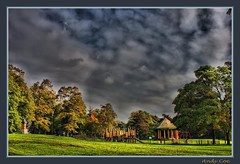 Rosehill park play area and bandstand (Andy Coe) Tags: park autumn trees sky house storm colour grass sunshine victoriapark play sony swings colourful alpha bandstand sureal rosegarden hdr greysky rotherham southyorkshire a700 rawmarsh rosehillpark