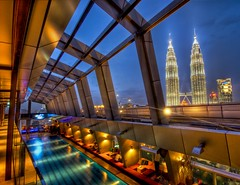 The Sky Bar in Kuala Lumpur with a view of Petronas (Stuck in Customs) Tags: pictures life lighting travel roof party sky panorama colors pool beautiful lines architecture bar night skyscraper work lunch photography lights design la nikon downtown shoot photographer open shot angle photos interior air magic details petronas towers perspective drinking indoor images shangrila adventure edge malaysia attractive pro nightlife kuala kualalumpur top100 capture 2008 malaysian interiordesign hdr klcc tutorial lumpur shangri trader skybar highquality travelphotography overwhelming traders tradershotel d2xs hdrtutorial stuckincustoms treyratcliff