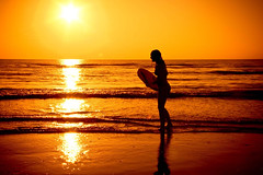 Surf Girl (siebe ) Tags: sunset sun holland beach girl dutch strand zonsondergang surf nederland thenetherlands zee surfboard noordwijk langevelderslag strandstock