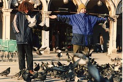 Europe 1996 r4 17 Venice, Italy - Donnie & Nick with the pigeons in San Marco square (Chris Devers) Tags: trip travel venice vacation italy building slr bird film church animal architecture 35mm italian nikon europe italia catholic pigeon basilica nick religion 1996 eu it donald christian nicholas ita donnie nikkor venizia venezia stmarks sanmarco stmarkssquare nikkormat stmarksbasilica sanmarcobasilica sanmarcosquare venesia meta:exif=none cameranikomat cameranikkomat exif:filename=dscjpg meta:exif=1350405740