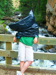 Sense? Makes none (honeymuffler) Tags: bridge girl rain river hilarious cool colorado funny break awesome relaxing shorts trashbag