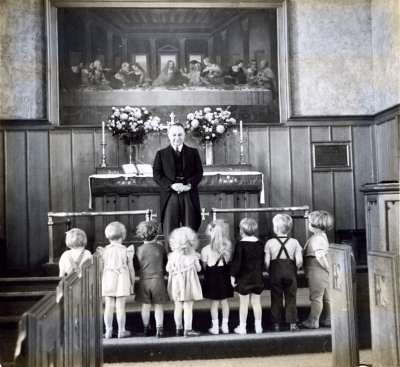 Children in the nave with a former pastor