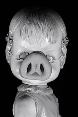 Creepy Doll Sports A Pig Nose (Charlie the Cheeky Monkey) Tags: bw white black canon wow nose pig weird do hell odd ugly um what did tonight awful fortmyers creepydoll i