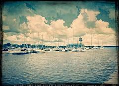 Vintage Erie Presque Isle Bay (:: Igor Borisenko Photography ::) Tags: water look clouds marina vintage boats crossprocessed waves artistic pennsylvania dramatic textures pa ripples aged erie yachts toned effect allrightsreserved cs3 presqueislebay supershot nastalgic impressedbeauty igorborisenkophotography