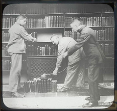 flickr photo: Three men at dusting books