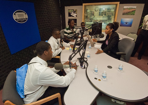 Seniors from Calvert High School Calvert, Texas (L to R) Jamarion Ramirez, Ja'Marcus Ashley, Andre Ross, and Blair Burns have an opportunity to experience the USDA Creative Media and Broadcast Center radio studio with USDA Radio broadcaster Susan Carter.