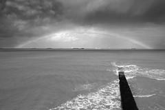 Rainbow (chrisfriel) Tags: blackandwhite beach landscape rainbow coastal unitedkingdon chrisfriel bnpaesaggio