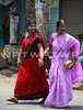 Crossing in Colour (WanderWorks) Tags: street pink ladies red woman india color colour sunshine gold women dress indian watch daughter mother kerala clothes chain package sari tamil sandal bindi nadu
