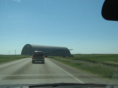 Quonset being moved, near Coronach, SK