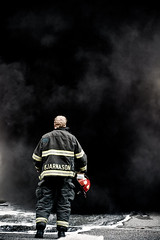 Facing the Beast (halfgeek) Tags: people men fire smoke working badge northvancouver firefighting careers pleasantlytilted
