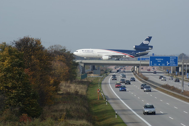 Airplane over road cars Leipzig